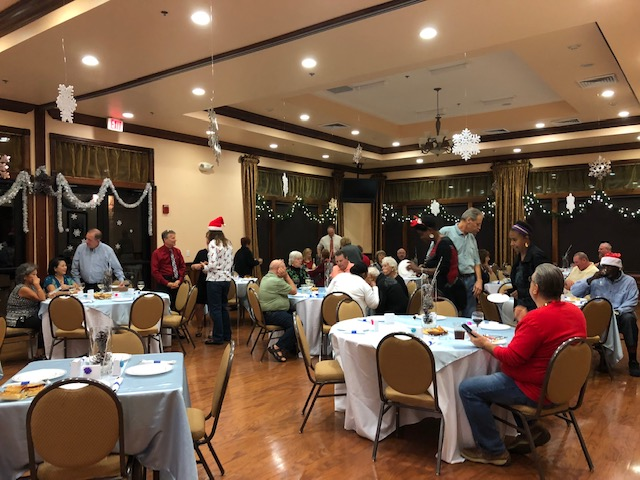 residents celebrating the winter season at a holiday party