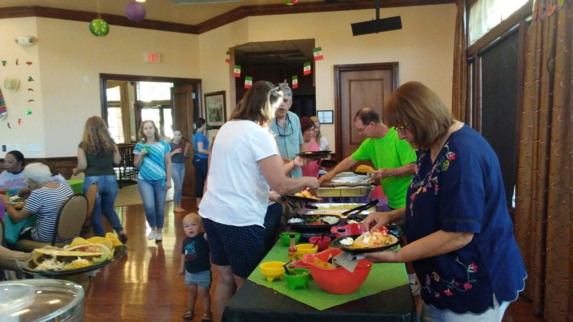 residents celebrating mexican heritage at a buffet