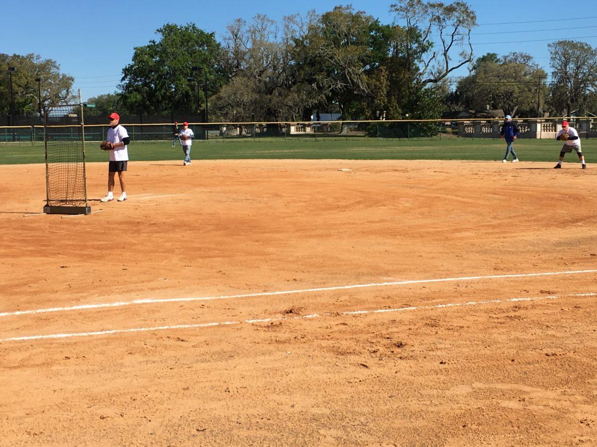 residents playing softball at leland games