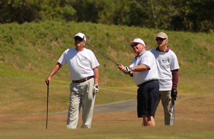 three men playing golf at leland games