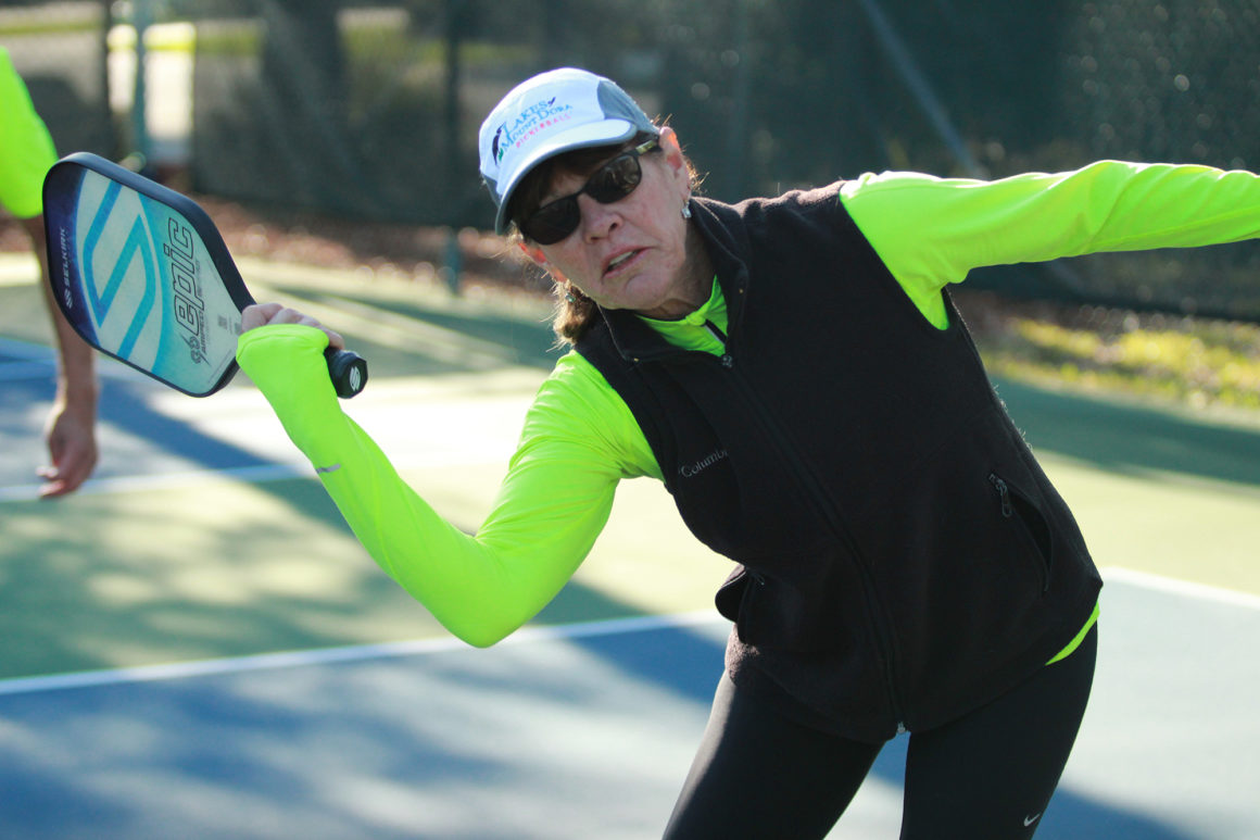 elderly woman playing pickleball at the leland games 2018