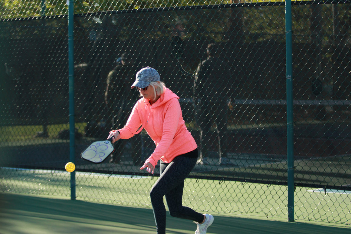 middle-aged woman playing pickleball at the leland games 2018