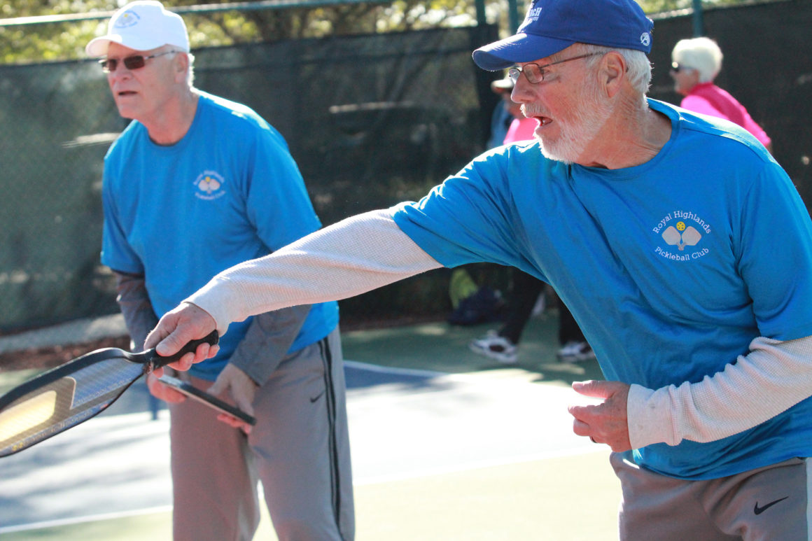 elderly men playing pickleball at the leland games 2018